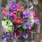 Lilac Colored Stock, Key Lime Green Hydrangea, Coral Charm Peony, Red Kale, Pink Veronica, Aubergine hued Clematis by Glenwood Weber Design