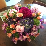 Violet Mokara Orchids, Blush and Magenta Peony, Peach Spray Roses, Grape Hydrangeas, Green Trichelium and Apple Green Hypericum Berries by Glenwood Weber Design