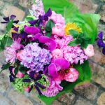 UltraViolet Hydrangea, Purple Orchids, Pink Peony, Hosta Foliage, Yellow Pin Cushion Baby Pink Ranunculus, Purple Clematis, Green Viburnum by Glenwood Weber Design