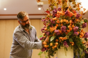 Glenwood Weber prepping large floral arrangement for Bar Mitzvah