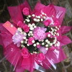 Sweetheart Roses, Delicate Button Poms, Pink Peonies in Complementary Pink Tissue Paper