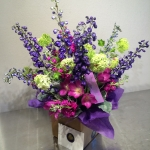 Chartreuse Viburnum, Blue Hybrid Delphinium, Wine colored Stock, Eggplant Tulips and Dusty Miller by Glenwood Weber Design