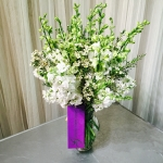 All White bouquet composed of white larkspur, stalk and wax flower