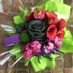 Mango Calla Lily, Purple Kale, Sorbet Colored Ranunculus, Magenta Stock, Violet Freesia, Blue Veronica and Green Trichelium by Glenwood Weber Design