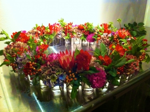 Assorted Flowers in small vases in a circle