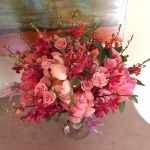 Coral Peony, Red and Orange Thai Mokara Orchids, Peach Spray Roses, Purple Passion Flower Vine by Glenwood Weber Design