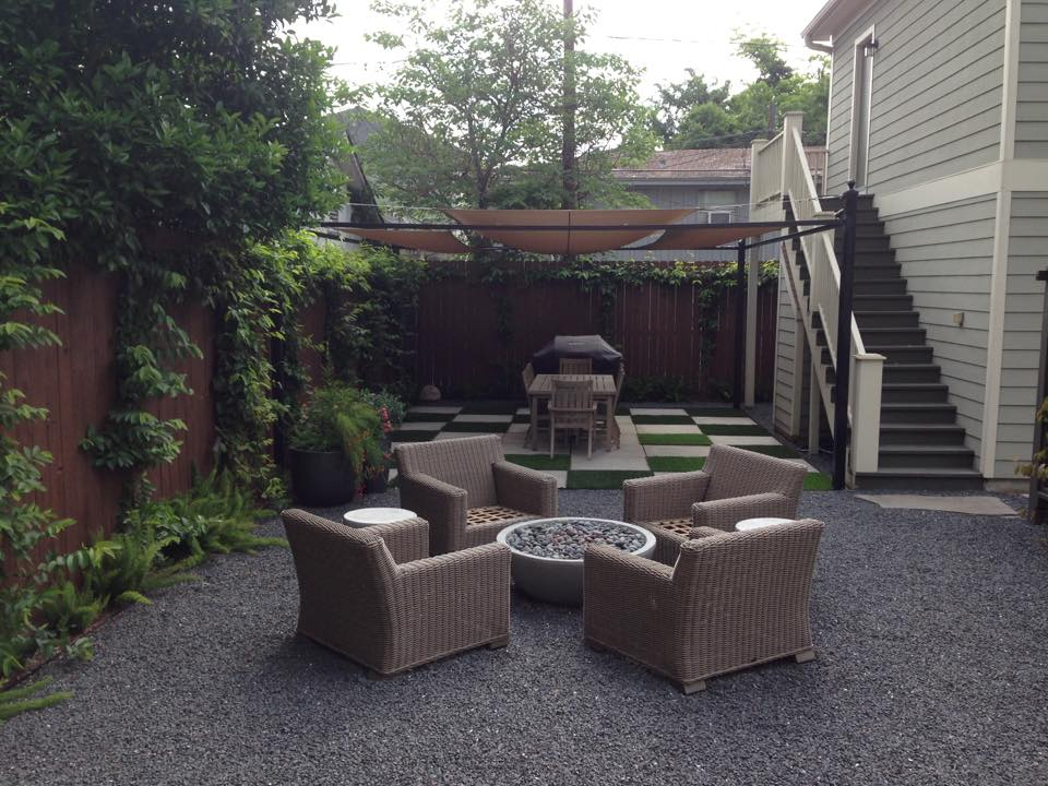 Fire Pit Lounge Area in an open air gravel courtyard next to sun sail covered outdoor dining area