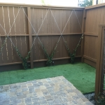 Artificial Sod with Trellis along the fence