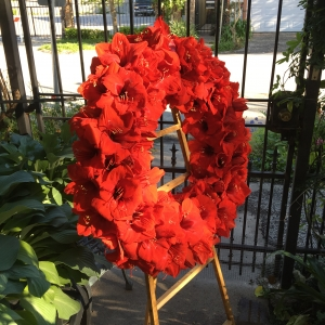 Sympathy Wreath on Wooden Easel with Red Amaryllis