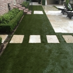 Artificial Sod laid with backyard walkway
