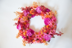 Sympathy Wreath with Pink, Hot Pink and Coral Peonies, Red and Orange Mokara, Orange Sweetheart and Samba Roses