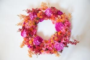 Sympathy Wreath with Pink, Hot Pink and Coral Peonies, Red and Orange Mokara, Orange Sweetheart and Samba Roses