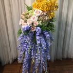 Sympathy Standing Spray Easel with French Blue Delphinium, Quicksand Roses, Antique Hydrangeas and Yellow Mokara Orchids