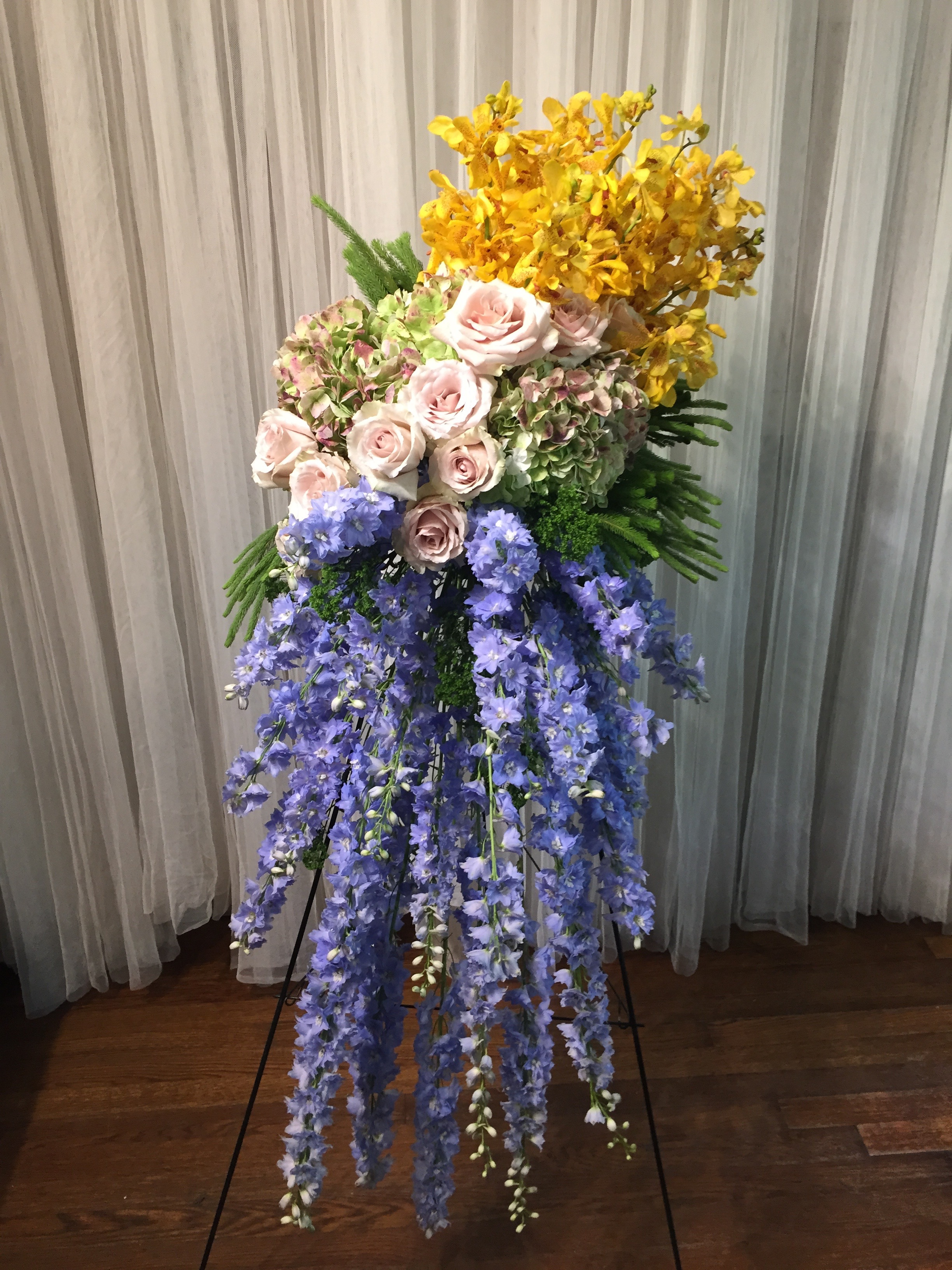 Houston custom sympathy tributes wreaths glenwood weber design sympathy standing spray easel with french blue delphinium quicksand roses antique hydrangeas and yellow izmirmasajfo